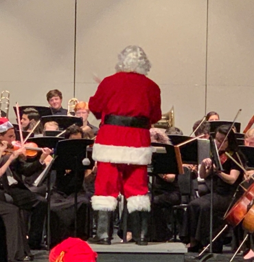 Look who is conducting the Full Orchestra....Santa's in the House!